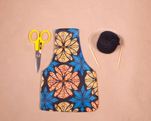 Small knitting bag for makers with a blue waxed cotton print exterior. Handmade in Africa by Chameleon Goods.