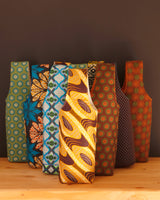 We have too much wine, said no one ever. Carry your next bottle (or bottles) of wine in one of our colorful cotton print wine carriers. They're lightly padded, fully lined, and handmade in Africa by Chameleon Goods.
