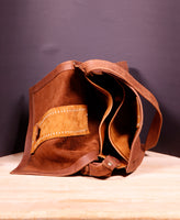Hand stitched brown leather shoulder bag with magnetic snap closure