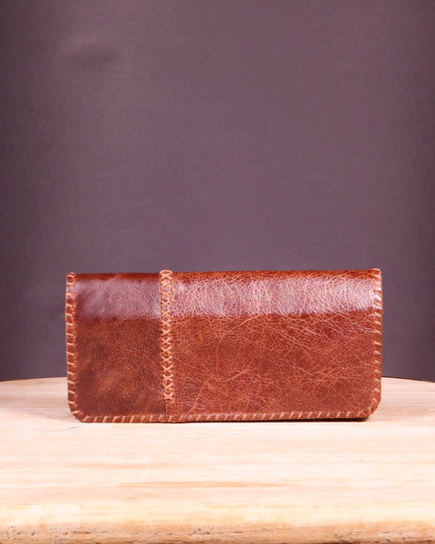 Hand-stitched brown leather wallet with pigskin lining. 12 card slots + 2 full-length pockets.