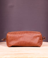Hand stitched brown leather toiletry bag with zipper closure