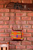 Brown Leather Crossbody Bag with Kente Cloth handmade in Africa by Chameleon Goods