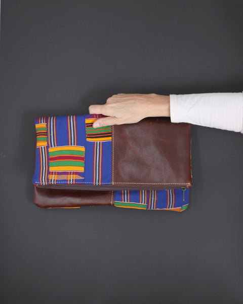 Leather foldover clutch bag with Kente cloth; handmade in Africa by Chameleon Goods