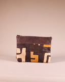 Front view of our large brown leather clutch with Kuba cloth. Handmade in Africa by Chameleon Goods.