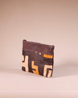 Side view of our large brown leather clutch with Kuba cloth. Handmade in Africa by Chameleon Goods.