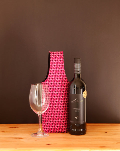 Make your wine pretty in pink with the lightly padded cotton wine tote from Chameleon Goods.