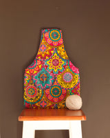 Medium knitting bag for makers in a colorful waxed cotton print. Handmade in Africa by Chameleon Goods.