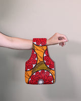 Carry one of our small knitting bags over your arm when you're knitting on the go. Handmade in Africa with a colorful waxed cotton print by Chameleon Goods.