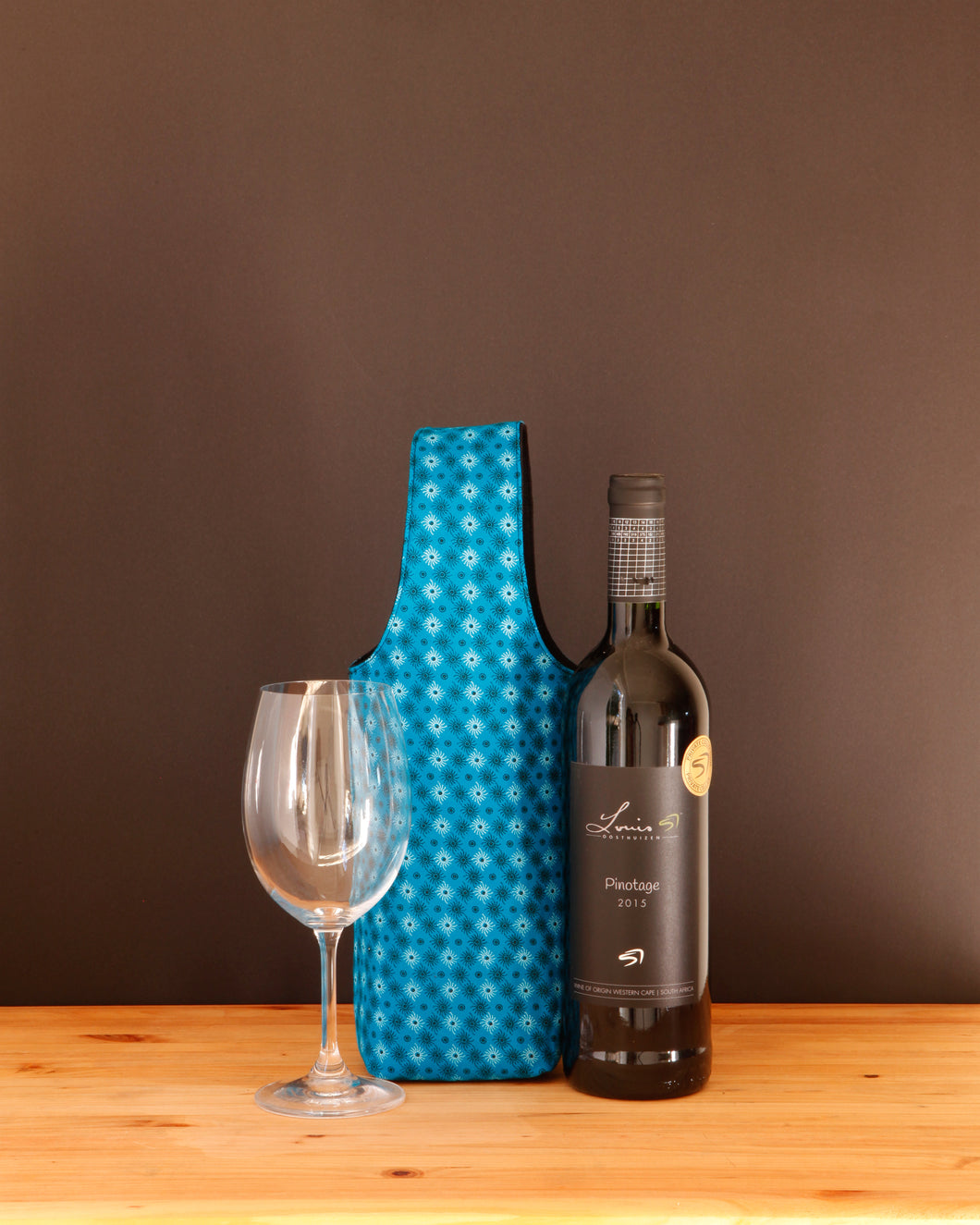 Wine (n.) - A hug in a glass. Give your friend *and* your wine a hug when you carry your bottle in one of our colorful wine totes.  Handmade in Africa by Chameleon Goods.