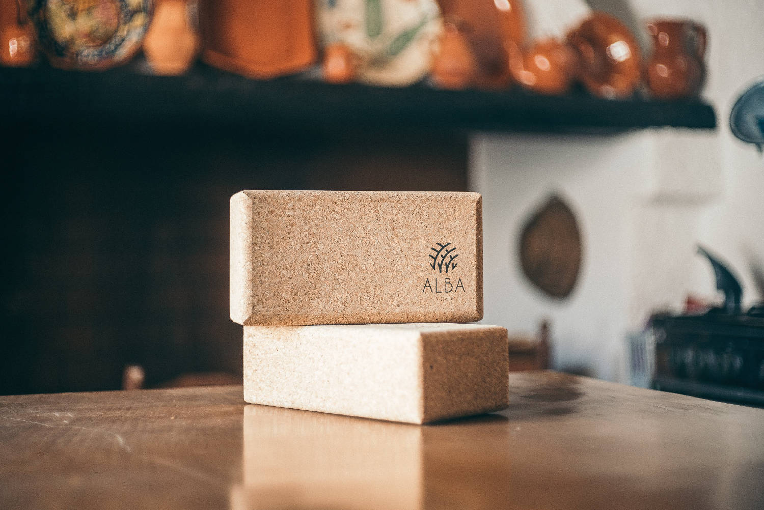 Alba Yoga cork yoga blocks stacked on top of each other on a table.