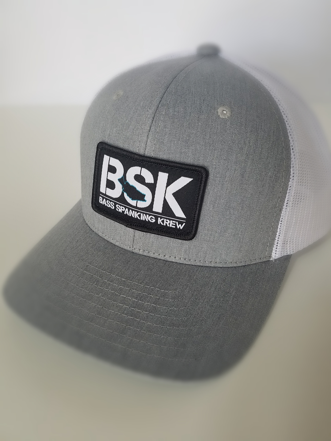 01d8dd7c76d80 Pre Curved Trucker Grey White With Woven Patch – BASS SPANKING KREW ™