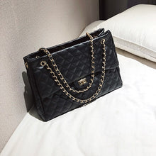 Woman's Long Single Strap Glam Bag
