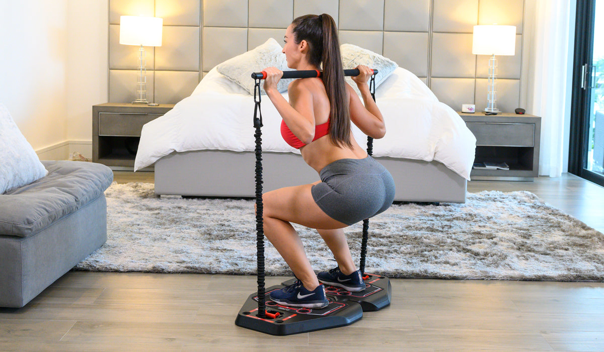 Woman exercising at home with her fusion board