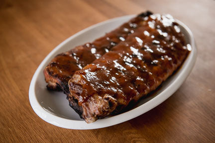 Grilled Baby Back Pork Ribs with Peach Barbecue Sauce