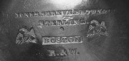 Fig. 2. Marks underneath one teapot, including the incuse R. & W. maker's mark of Rogers & Wendt. The R. & W. mark has been observed with and without Boston and with and without a retailer's mark
