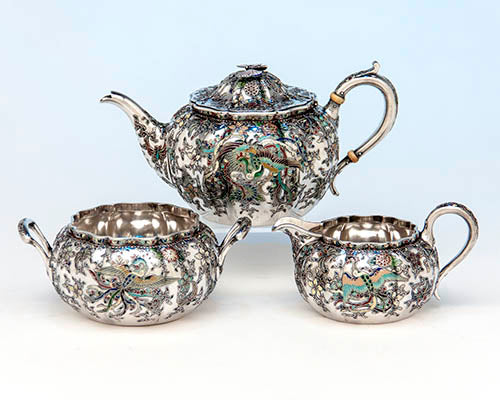 Japanese Work Sample tête-à-tête service number 8768, 1897–1898. Silver and enamel: teapot height 3 ¾ width 7 ½ inches; sugar bowl height 2 ⅜, width 5 ¾ inches; milk pot height 2 ¾, width 5 inches. Philadelphia Museum of Art, purchased with funds contributed by Marguerite and Gerry Lenfest