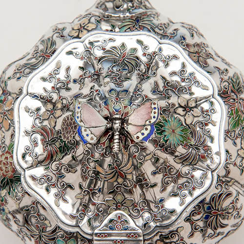 Detail of butterfly finial and lid of the teapot on the tête-a-tête service in Fig 5