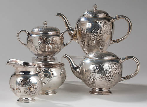 Japanese Work Sample tea and coffee service number 8738, 1897–1898. Silver; coffee pot height 6 ¼ inches. Northeast Auctions photograph.