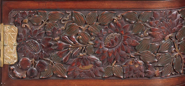 Carved pomegranate panel on the Herter Brothers cabinet for William H. Vanderbilt, 1879-82, courtesy of Metmuem.org