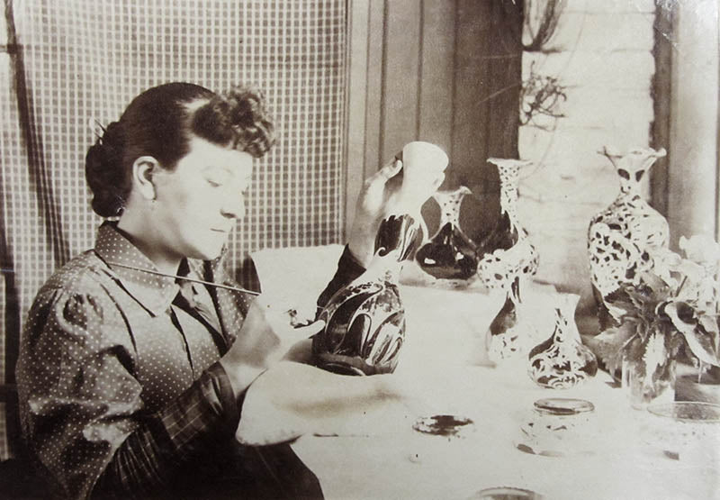 A woman decorating a 2020 model vase with floral decoration.  Photo courtesy Porvidence Public Library