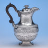 The Baring Family English Sterling Silver Hot Water Jug or 'Turkey Coffee Pot' by Robert Garrard, London, c. 1822/23, bearing the arms of Baring as borne by Sir Francis-Thornhill Baring, 3rd Baronet and First Baron Northbrook