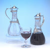 Pair of Tiffany Sterling Silver Mounted Cut Glass Decanters or 'Claret Jugs', c. 1894