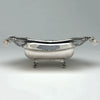 Side view of the Fletcher & Gardiner Antique Coin Silver Bread Basket, Philadelphia, c. 1815, Retailed by J. B. Jones in Boston