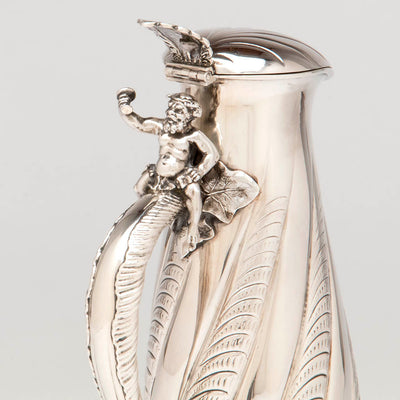 Bacchanal on handle of the Gorham Antique Sterling Silver Champagne Pitcher, Providence, RI, 1887
