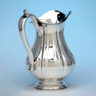 Angle view of Arthur Stone Associates Arts & Crafts Sterling Silver 'Fluted' Water Pitcher, c. 1930's