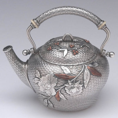 Tea pot detail of Whiting - The Bowers/ Taft Family Aesthetic Movement Sterling Silver and Mixed-Metal Tête-à-tête Tea Service, c. 1887