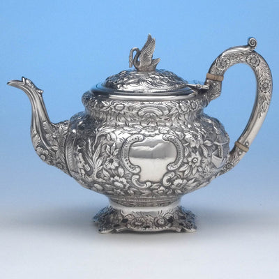 Reverse of Samuel Kirk 11oz Silver Repoussé Chinoiserie Teapot, c. 1834-46, bearing the crest and arms of Maryland Governor Thomas Swann (1809-1883)
