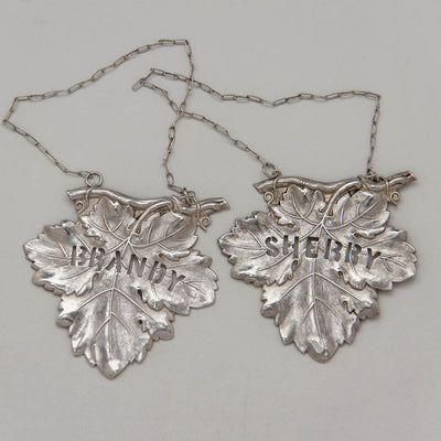 Pair of Eoff & Shepard Rare Coin Silver Decanter Labels, New York City, 1852-60