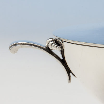 Side handles of Tuttle Silversmiths Sterling Silver Modernist Covered Bowl, Boston, 1938