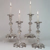 Four George II candlesticks, 3 James Gould, 1 Eliza(beth) Godfrey, c. 1740's