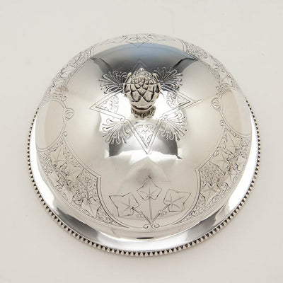 Ivy on top of Tiffany & Co. Ivy Engraved Antique Sterling Silver Covered Butter Dish, New York City, 1865-70