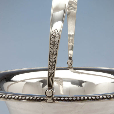 Handle decoration on Harvey Lewis Antique Coin Silver Swing-handle Basket, Philadelphia, 1811-1828