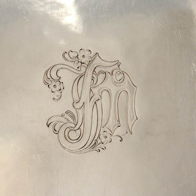 Monogram detail on the The Kalo Shop Arts & Crafts Sterling Chased Presentation Service Plates, Chicago, IL, 1915 set of 12