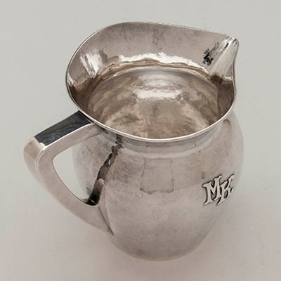 Angle view of the Lebolt Sterling Silver Arts & Crafts Milk Pitcher, Chicago, c. 1920