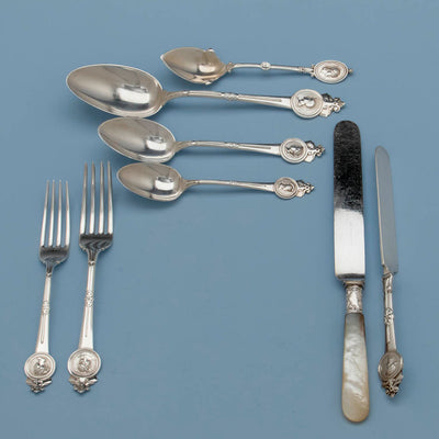 Place setting of Gorham/ Wendt 'Medallion Pattern Antique Sterling Flatware Service, Providence, NYC, mid 1860's