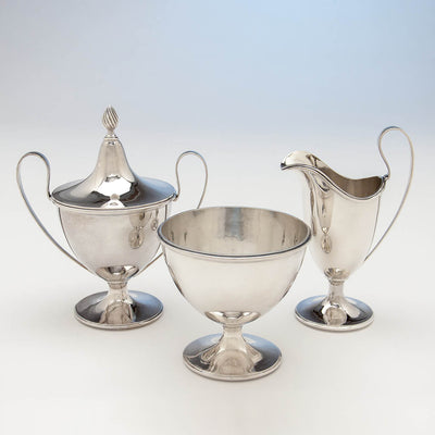 Sugar bowl, creamer and waste bowl of Gebelein Arts & Crafts 5-piece Sterling Silver Tea Service, Boston, c. 1920