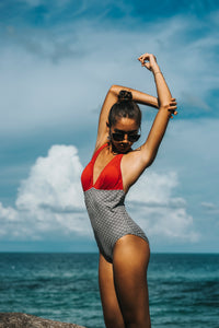 Red top and printed bottom one piece swimming suit.