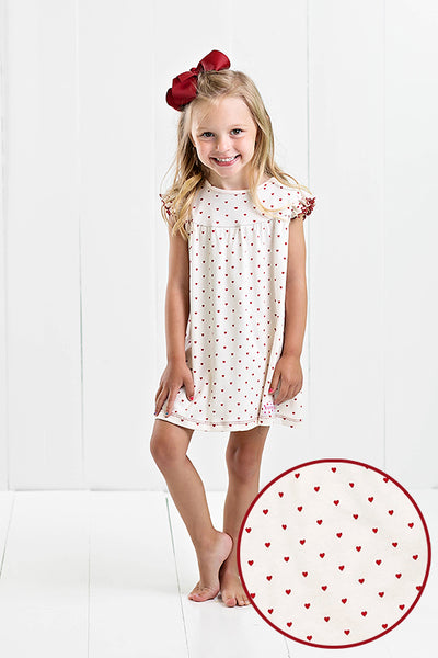 cream and crimson dress with hearts