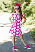 pink dress with white hearts