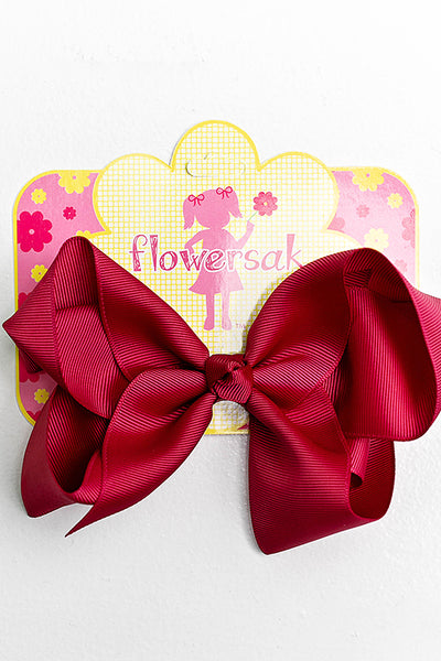 bright maroon bow with clip