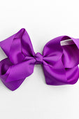 bright purple bow with clip