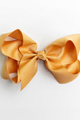 golden yellow bow with clip