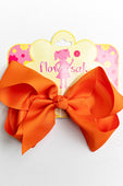 orange bow with clip
