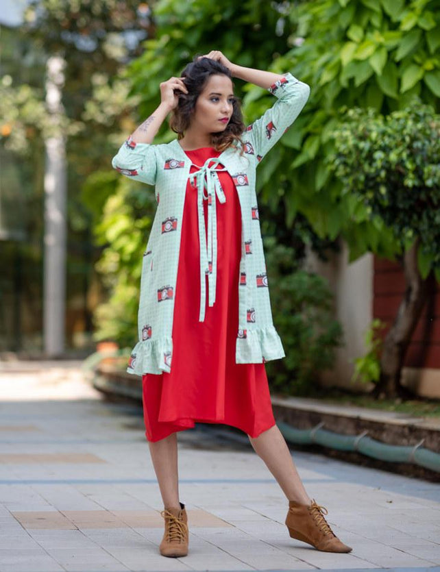 Camera print jacket with red dress