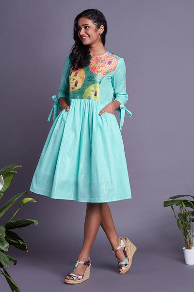 Turquoise gather and ribbon dress