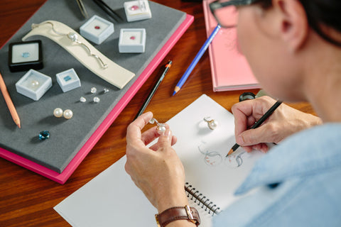 "Our in-house jeweller, Leah Abercrombie, sketching her award-winning custom design pearl earrings called ""Autumn Dream""."